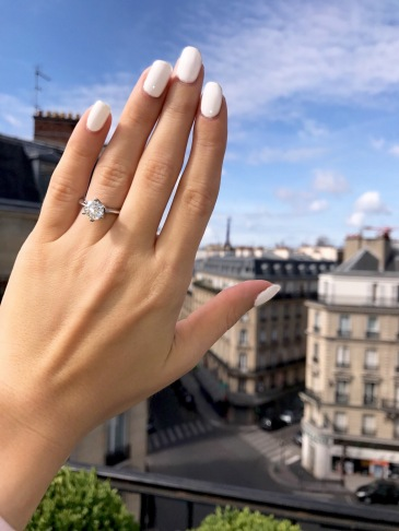 engaged engagement ring proposal couple paris travel france eiffel tower